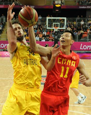 Australian forward Matt Nielsen (L) vies with Chinese centre Yi Jianlian during the men's preliminary round Groupe B basketball match Australia vs China of the London 2012 Olympic Games  on August 2, 2012 at the basketball arena in London. (MARK RALSTON / AFP/Getty Images)