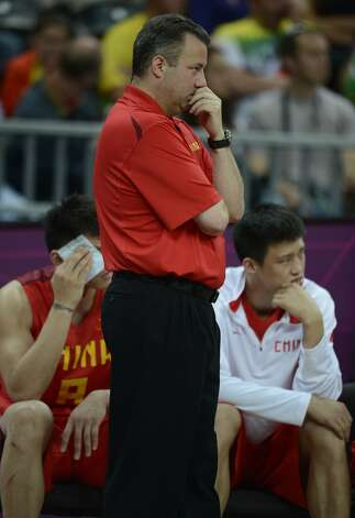 Chinese coach Robert Donewald Jr watch the game during the men's preliminary round Groupe B basketball match Australia vs China of the London 2012 Olympic Games  on August 2, 2012 at the basketball arena in London. (TIMOTHY A. CLARY / AFP/Getty Images)