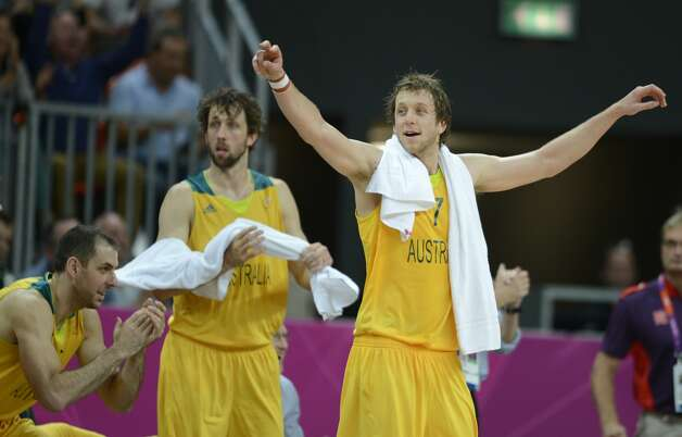 Australian forward Joe Ingles and Australian forward Matt Nielsen (R) celebrate at the end of the men's preliminary round Groupe B basketball match Australia vs China of the London 2012 Olympic Games  on August 2, 2012 at the basketball arena in London. Australia won 49-23. (TIMOTHY A. CLARY / AFP/Getty Images)