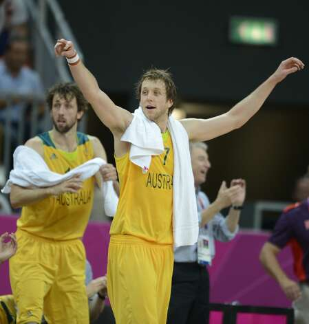 Australian forward Joe Ingles and Australian forward Matt Nielsen (L) celebrate at the end of the men's preliminary round Groupe B basketball match Australia vs China of the London 2012 Olympic Games  on August 2, 2012 at the basketball arena in London. Australia won 49-23. (TIMOTHY A. CLARY / AFP/Getty Images)