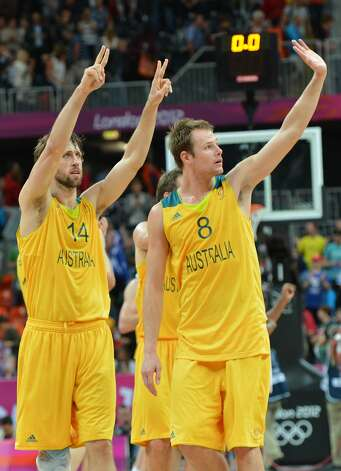 Australian forward Matt Nielsen and Australian forward Brad Newley (R) celebrate at the end of the men's preliminary round Groupe B basketball match Australia vs China of the London 2012 Olympic Games  on August 2, 2012 at the basketball arena in London. Australia won 49-23. (MARK RALSTON / AFP/Getty Images)