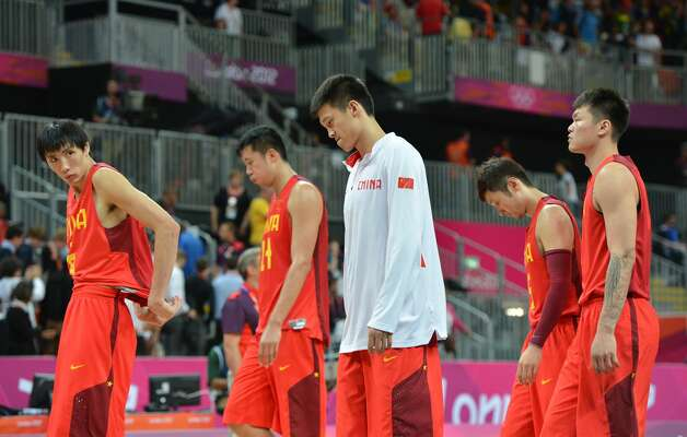 Chinese players look dejected at the end of the men's preliminary round Groupe B basketball match Australia vs China of the London 2012 Olympic Games  on August 2, 2012 at the basketball arena in London. Australia won 49-23. (MARK RALSTON / AFP/Getty Images)
