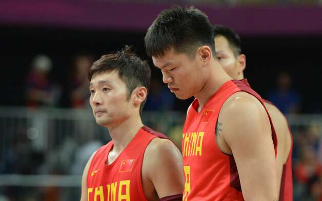 Chinese guard Liu Wei (L) and Chinese forward Zhu Fangyu look dejected at the end of the men's preliminary round Groupe B basketball match Australia vs China of the London 2012 Olympic Games  on August 2, 2012 at the basketball arena in London. Australia won 49-23. (MARK RALSTON / AFP/Getty Images)