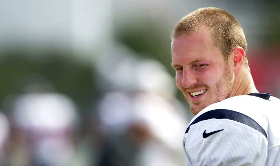 A lot has changed in the last 12 months for second-year Texans quarterback T.J. Yates, who entered training camp with an NFL playoff victory on his résumé. Photo: Brett Coomer / © 2012 Houston Chronicle