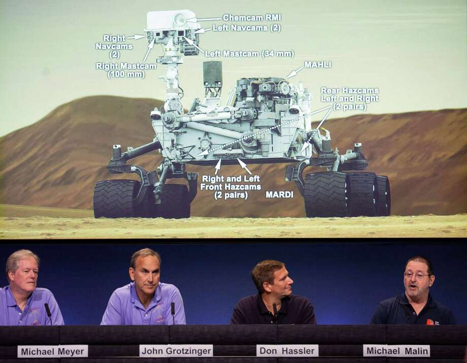 Scientists talks about the cameras aboard the Curiosity Mars Rover, background, during a media briefing at NASA's Jet Propulsion Laboratory in Pasadena, Calif., last week. Photo: Damian Dovarganes, Associated Press / AP