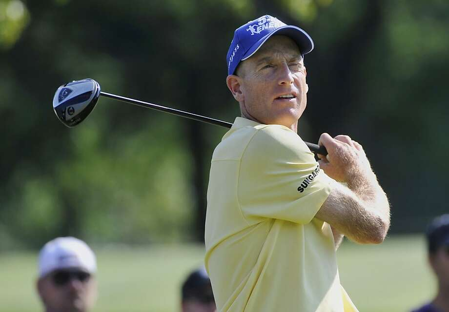 Jim Furyk watches his tee shot on the ninth hole, during the first round of the Bridgestone Invitational golf tournament at Firestone Country Club, Thursday, Aug. 2, 2012, in Akron, Ohio. Furyk made par on the hole. (AP Photo/Phil Long) Photo: Phil Long, Associated Press