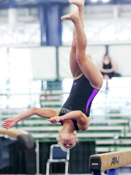 Courtney Pesta,17, from Port Huron, MI. competes on the balance beam in the Jr. Olympics in the Gymn
