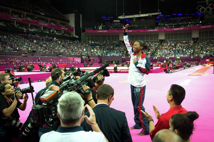 U.S. gymnast Gabrielle Douglas waves to the crowd after winning the gold medal in the women's gymnas