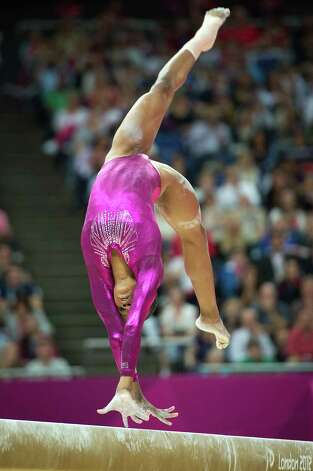 U.S. gymnast Gabrielle Douglas performs on the balance beam during the women's gymnastics individual all-around final at the 2012 London Olympics on Thursday, Aug. 2, 2012. Photo: Smiley N. Pool, Houston Chronicle / © 2012  Houston Chronicle
