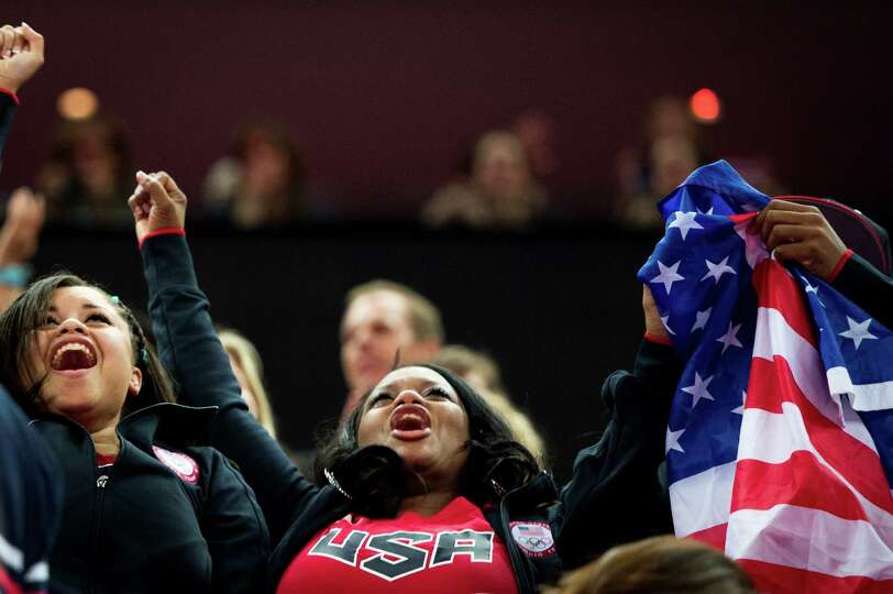 Natalie Hawkins, mother of U.S. gymnast Gabrielle Douglas, cheers after her daughter won the gold me
