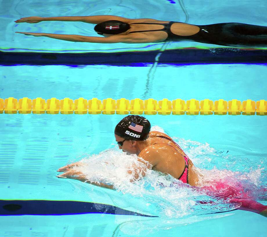 Rebecca Soni of the USA swims to the gold medal in the women's 200m breaststroke in a world record time of 2:19.59 at the 2012 London Olympics on Thursday, Aug. 2, 2012. Photo: Smiley N. Pool, Houston Chronicle / © 2012  Houston Chronicle