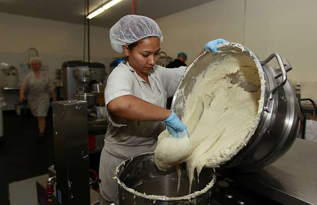 Bertha Dominguez prepares gluten-free dough for sandwich bread at the bakery Pure Knead in Decatur, Ga. Photo: John Bazemore, Associated Press