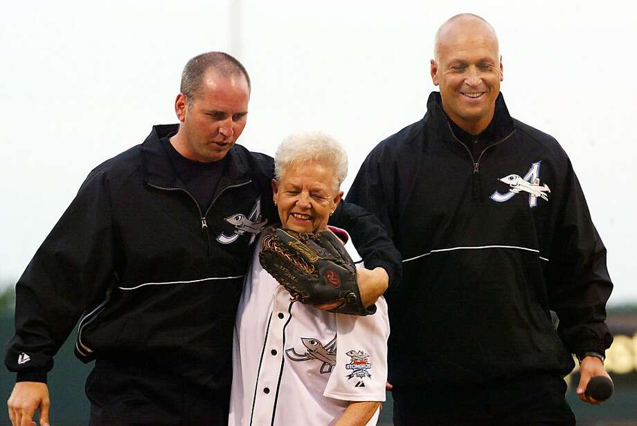 FILE - This June 18, 2002 file photo shows Cal Ripken Jr., right, owner of the Aberdeen IronBirds, and his brother, Bill, walking off the field with their  mother, Vi, after she threw out the ceremomial first pitch prior to the team's season-opening debut at the new Ripken Stadium in Aberdeen, Md. Police say Cal Ripken Jr.'s mother is safe after an armed man abducted her from her home northeast of Baltimore. Aberdeen police say 74-year-old Vi Ripken was kidnapped between 7 a.m. and 8 a.m. Tuesday, July 24, 2012,  by a man who forced her into her car. (AP Photo/Roberto Borea, File) Photo: Roberto Borea, Associated Press