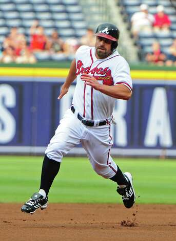 ATLANTA, GA - AUGUST 2: Reed Johnson #11 of the Atlanta Braves rounds the bases against the Miami Marlins at Turner Field on August 2, 2012 in Atlanta, Georgia. Photo: Scott Cunningham, Getty Images / 2012 Getty Images