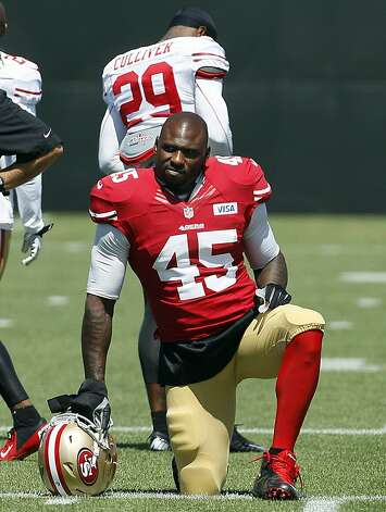 San Francisco 49ers running back Brandon Jacobs kneels at practice at an NFL football training camp in Santa Clara, Calif., Thursday, Aug. 2, 2012. (AP Photo/Jeff Chiu) Photo: Jeff Chiu, Associated Press