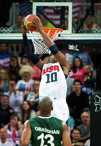 USA's Kobe Bryant dunks the ball past Nigeria's Derrick Obasohan during during a preliminary round men's basketball game at the 2012 London Olympics on Thursday, Aug. 2, 2012. Photo: Smiley N. Pool, Houston Chronicle / © 2012  Houston Chronicle