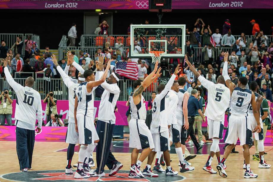 Team USA players wave to the crown after defeating Nigeria in a preliminary round men's basketball game at the 2012 London Olympics on Thursday, Aug. 2, 2012. Photo: Smiley N. Pool, Houston Chronicle / © 2012  Houston Chronicle