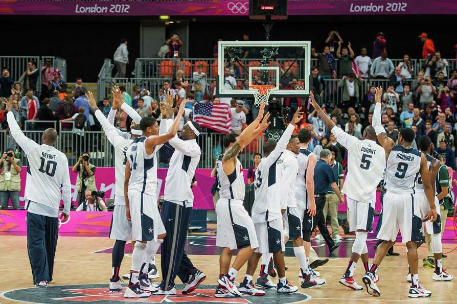Team USA players wave to the crown after defeating Nigeria in a preliminary round men's basketbal