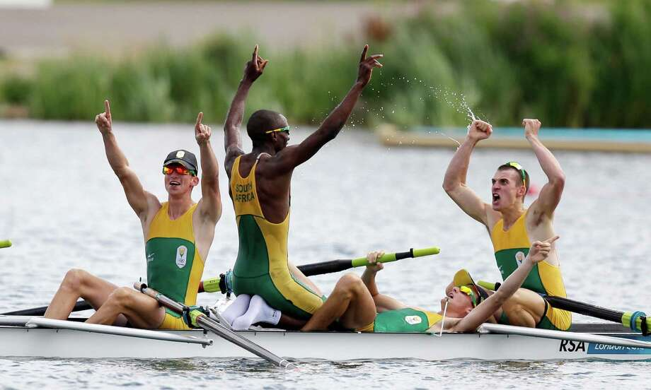 South Africa's, from left, Sizwe Ndlovu, John Smith, Mathew Brittain and James Thompson celebrate after winning the gold medal for the lightweight men's rowing four in Eton Dorney, near Windsor, England, at the 2012 Summer Olympics, Thursday, Aug. 2, 2012. (AP Photo/Natacha Pisarenko) Photo: Natacha Pisarenko, Express-News / AP