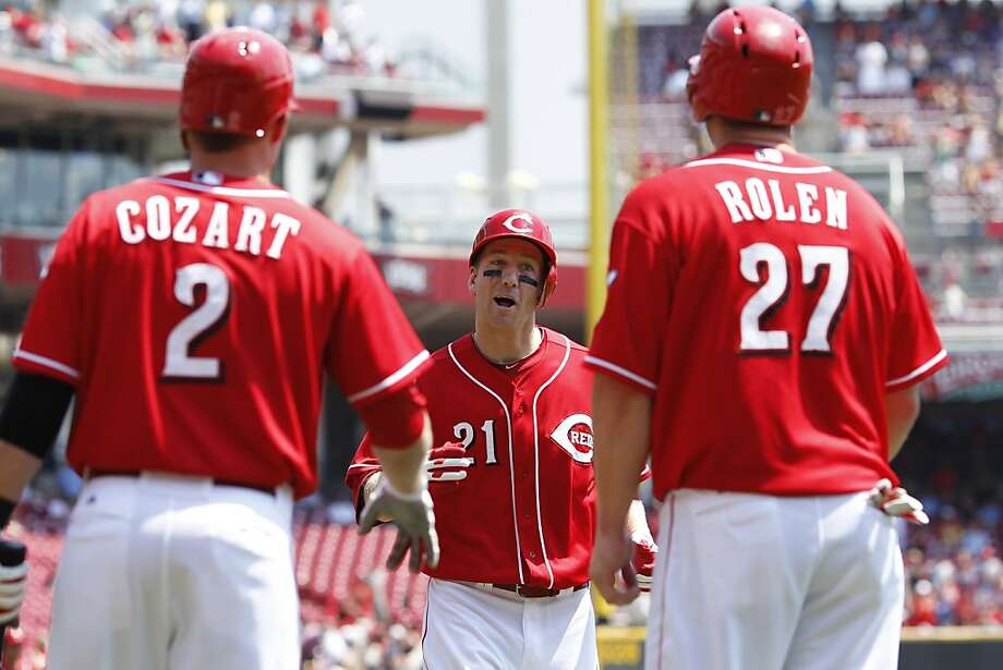 CINCINNATI, OH - AUGUST 2: Todd Frazier #21 of the Cincinnati Reds is met at home plate by teammates Zack Cozart #2 and Scott Rolen #27 after hitting a two-run homer in the second inning of the game against the San Diego Padres at Great American Ball Park on August 2, 2012 in Cincinnati, Ohio. (Photo by Joe Robbins/Getty Images) Photo: Joe Robbins, Getty Images