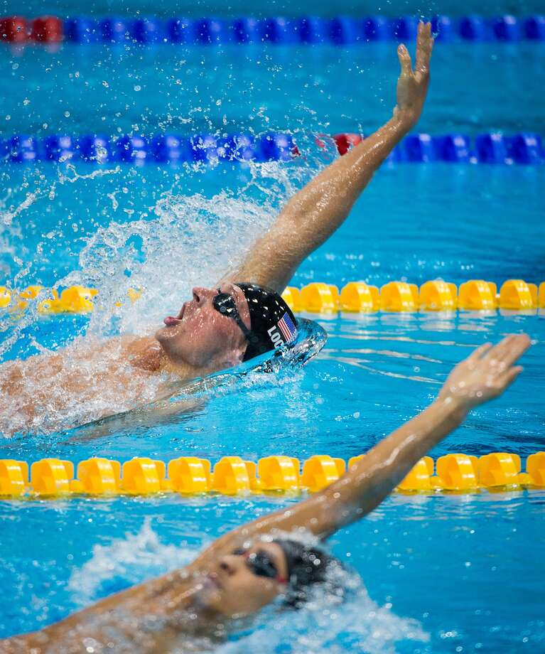 Ryan Lochte of the USA, top, swims in the men's at the 2012 London Olympics on Wednesday, Aug. 1, 2012. ( Smiley N. Pool / Houston Chronicle )