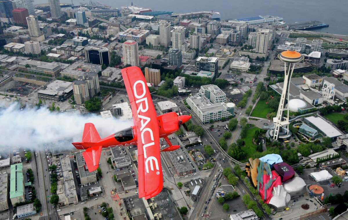 Sean D. Tucker flies over Seattle Center in the Oracle Challenger III, a 1,129-lb., 400+ horsepower biplane that can reach speeds of 300mph, during a practice run in Seattle on Thursday, August 2, 2012. Tucker, internatonally recognized as one of the premier civilian aerobatic performers worldwide, has logged over 24,000 flight hours and has been performing since the 1970s.