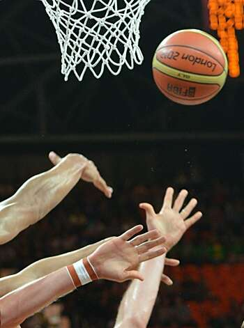 players fight for the ball during the men's preliminary round Groupe B basketball match Australia vs China of the London 2012 Olympic Games  on August 2, 2012 at the basketball arena in London. Australia won 49-23. (MARK RALSTON / AFP/Getty Images)