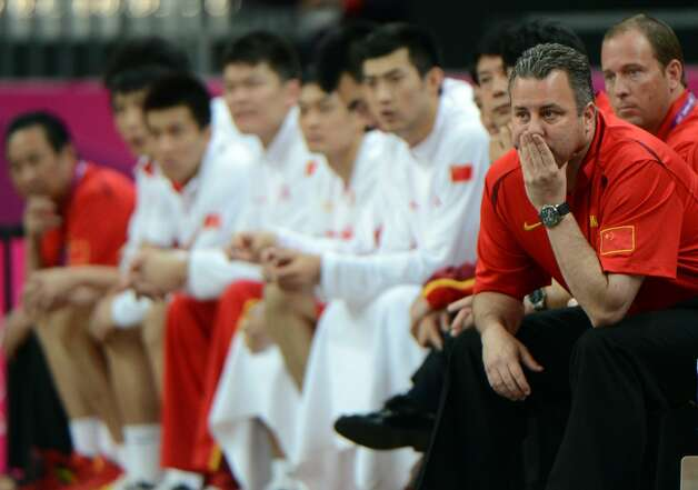 Chinese coach Robert Donewald Jr reacts during the men's preliminary round Groupe B basketball match Australia vs China of the London 2012 Olympic Games  on August 2, 2012 at the basketball arena in London. (MARK RALSTON / AFP/Getty Images)