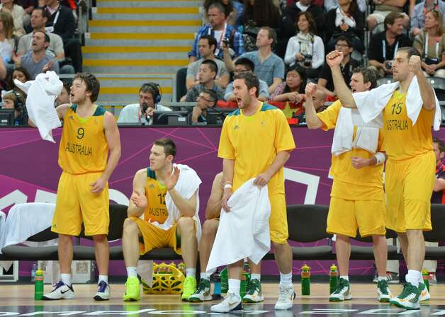 Australia players cheer during the men's preliminary round Groupe B basketball match Australia vs China of the London 2012 Olympic Games  on August 2, 2012 at the basketball arena in London. (MARK RALSTON / AFP/Getty Images)