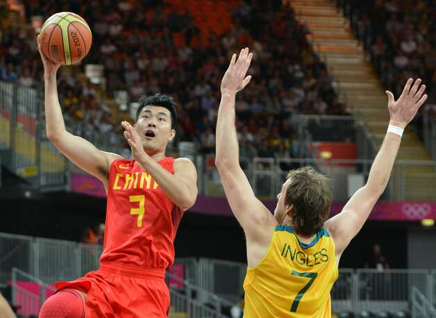 Chinese guard Wang Shipeng (L) vies with Australian forward Joe Ingles during the men's preliminary round Groupe B basketball match Australia vs China of the London 2012 Olympic Games  on August 2, 2012 at the basketball arena in London. (MARK RALSTON / AFP/Getty Images)