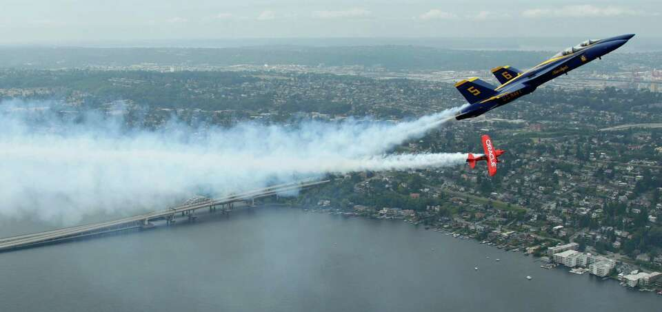 U.S. Navy Blue Angels pilots Lt. C.J. Simonsen (5) and Lt. David Tickle (6) fly in formation with Te