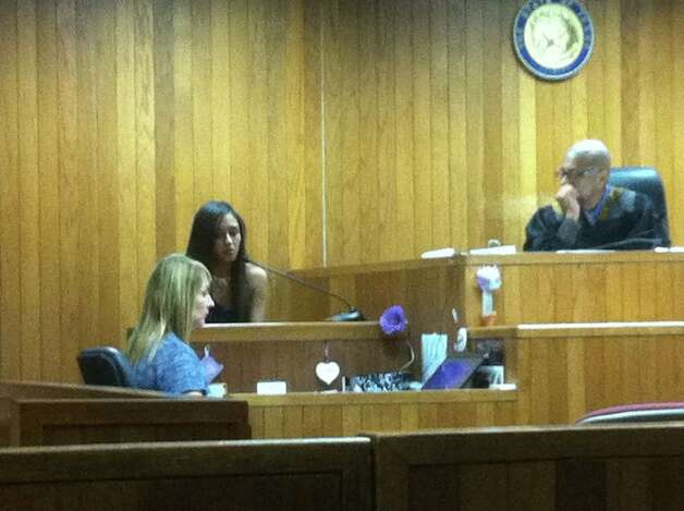 Melanie Garcia, 21, the mother of slain 4-year-old Kayla Garcia, testifies against co-defendant and ex-boyfriend Matthew Carrillo Thursday during a hearing before magistrate judge Andrew Carruthers. Garcia and Carrillo have both been charged with injury to a child causing serious bodily injury, a first-degree felony. Photo: Craig Kapitan/Express-News
