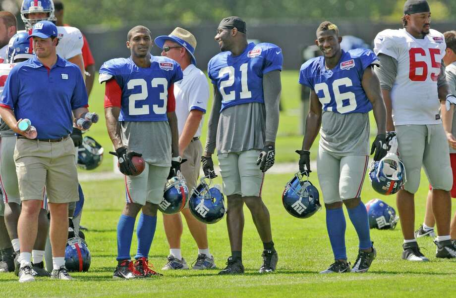 New York Giants cornerback Corey Webster, second from left, safeties Kenny Phillips, center, and Antrel Rolle, second from right,  during a training camp practice at UAlbany on Thursday Aug. 2, 2012 in Albany, NY.  (Philip Kamrass / Times Union) Photo: Philip Kamrass / 00018639A