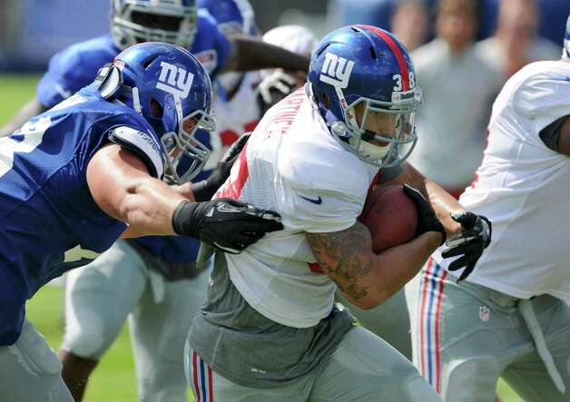 New York Giants running back Joe Martinek carries the ball during a training camp practice at UAlbany on Thursday Aug. 2, 2012 in Albany, NY.  (Philip Kamrass / Times Union) Photo: Philip Kamrass / 00018639A