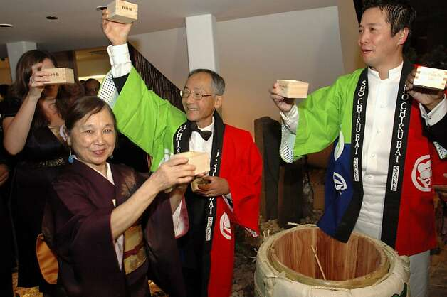 "Yoshi's founders Yoshie Akiba (left) and Kaz Kajimura share a sake toast with executive chef Shotaro ""Sho"" Kamio at Yoshi's San Francisco shortly after the club opened in 2007. Photo: Stuart Brinin"