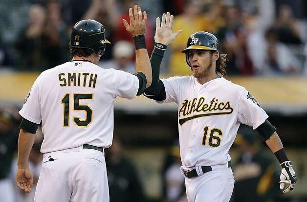 Oakland Athletics' Seth Smith (15) congratulates Josh Reddick (16) after Reddick hit a two-run home run off Toronto Blue Jays' Henderson Alvarez in the third inning of a baseball game, Thursday, Aug. 2, 2012, in Oakland, Calif. (AP Photo/Ben Margot) Photo: Ben Margot, Associated Press