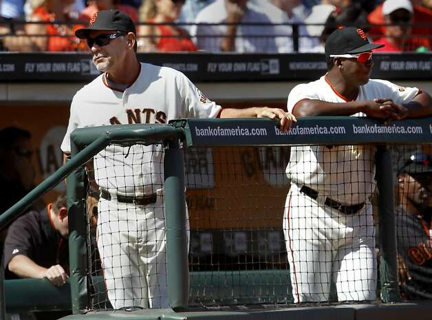 Giants manager Bruce Bochy (left) watched his team lose their third game against the Mets.  Batting coach Hensley Meulens is at right. The San Francisco Giants lost to the New York Mets on the final of a four game series Thursday August 2, 2012 at AT&T park. Photo: Brant Ward, The Chronicle