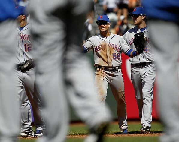 Former Giant Andrew Torres celebrated the Mets victory with teammates. The San Francisco Giants lost to the New York Mets on the final of a four game series Thursday August 2, 2012 at AT&T park. Photo: Brant Ward, The Chronicle