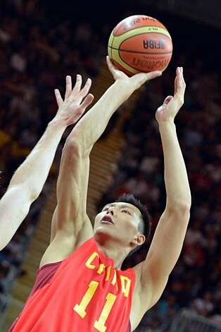 Chinese centre Yi Jianlian tries to score during the men's preliminary round Groupe B basketball match Australia vs China of the London 2012 Olympic Games  on August 2, 2012 at the basketball arena in London. (MARK RALSTON / AFP/Getty Images)