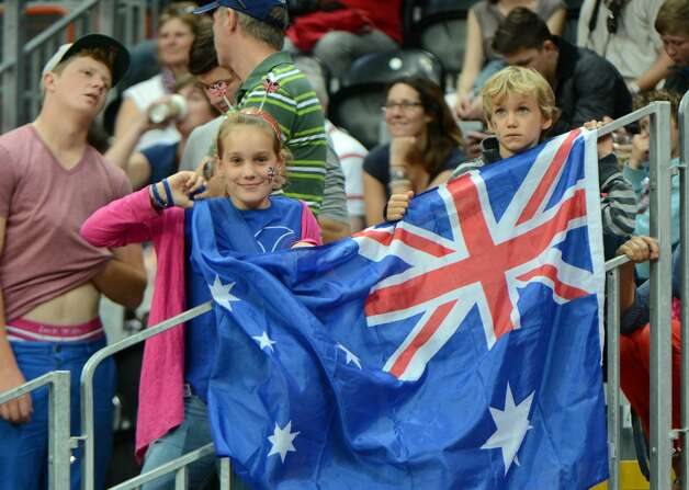 Australian fans cheer during the men's preliminary round Groupe B basketball match Australia vs China of the London 2012 Olympic Games  on August 2, 2012 at the basketball arena in London. (MARK RALSTON / AFP/Getty Images)