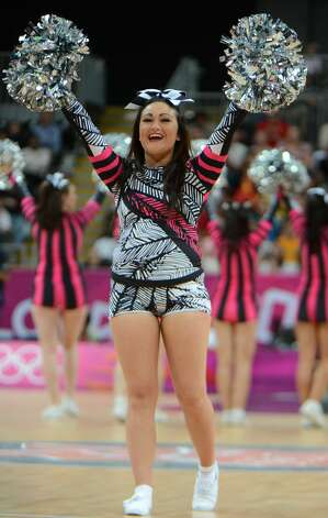 Cheerleaders perform during the men's preliminary round Groupe B basketball match Australia vs China of the London 2012 Olympic Games  on August 2, 2012 at the basketball arena in London. Australia won 49-23. (MARK RALSTON / AFP/Getty Images)