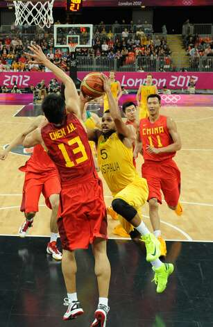 Australian guard Patrick Mills tries to score against Chinese guard Chen Jianghua during the men's preliminary round Groupe B basketball match Australia vs China of the London 2012 Olympic Games  on August 2, 2012 at the basketball arena in London. (MARK RALSTON / AFP/Getty Images)