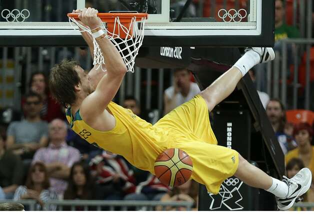 Australia's Joe Ingles hangs on the rim on a slam dunk against China during a men's basketball game at the 2012 Summer Olympics, Thursday, Aug. 2, 2012, in London. (Charles Krupa / Associated Press)