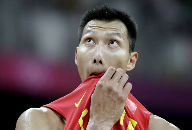 China's Yi Jianlian looks at the score board during a break in the team's preliminary men's basketball game against Australia at the 2012 Summer Olympics, Thursday, Aug. 2, 2012, in London. (Eric Gay / Associated Press)