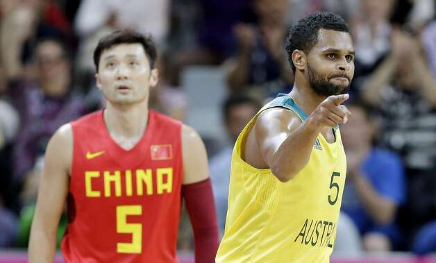 Australia's Patrick Mills, right, react after scoring over China's Liu Wei left, during a preliminary men's basketball game at the 2012 Summer Olympics, Thursday, Aug. 2, 2012, in London. (Eric Gay / Associated Press)