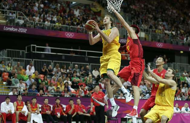 Australia's Joe Ingles drives to the basket past China's Zhu Fangyu during a men's basketball game at the 2012 Summer Olympics, Thursday, Aug. 2, 2012, in London. (Charles Krupa / Associated Press)