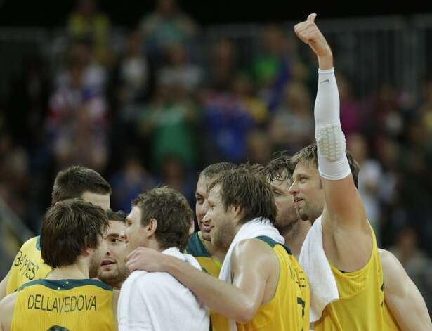 Australia's David Andersen holds a thumb up while gathering with teammates after beating China during a men's basketball game at the 2012 Summer Olympics, Thursday, Aug. 2, 2012, in London. (Charles Krupa / Associated Press)