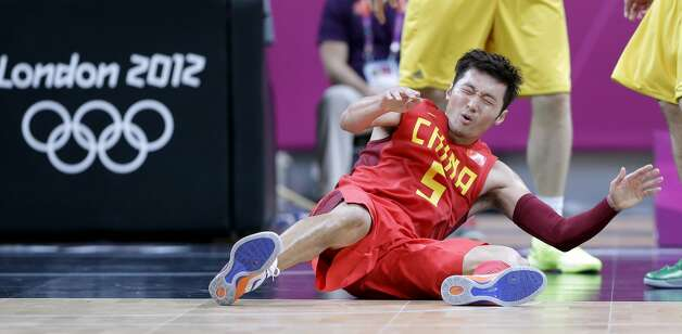 China's Liu Wei reacts as he falls to the floor during a preliminary men's basketball game against Australia at the 2012 Summer Olympics, Thursday, Aug. 2, 2012, in London. (Eric Gay / Associated Press)