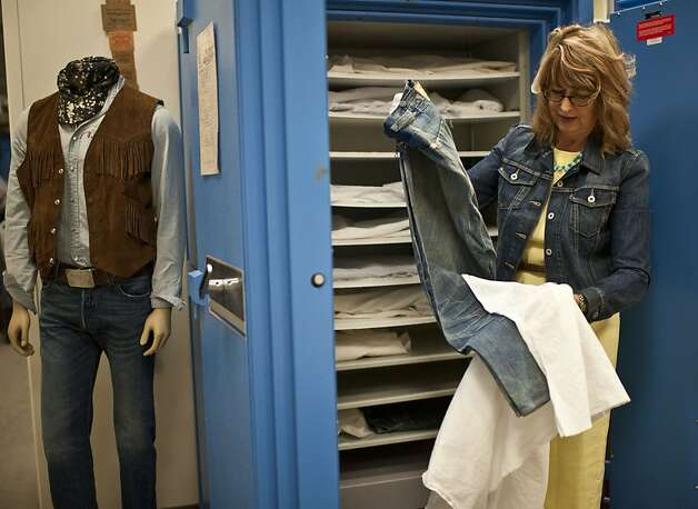 Levi's historian Lynn Downey shows the oldest pair of 501 jeans, which date back to 1879, at Levi's headquarters in San Francisco. Downey also regularly checks eBay, looking for old marketing and historic photos. Photo: Yue Wu, The Chronicle