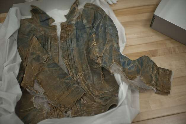 This riveted denim jacket, possibly the world's oldest, was found in a Southern California ghost town. Clothes found in abandoned mines get sold to Downey. Photo: Yue Wu, The Chronicle